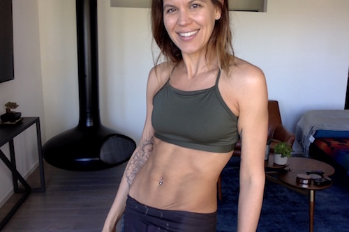 Lindsay Nixon showing off her abs.